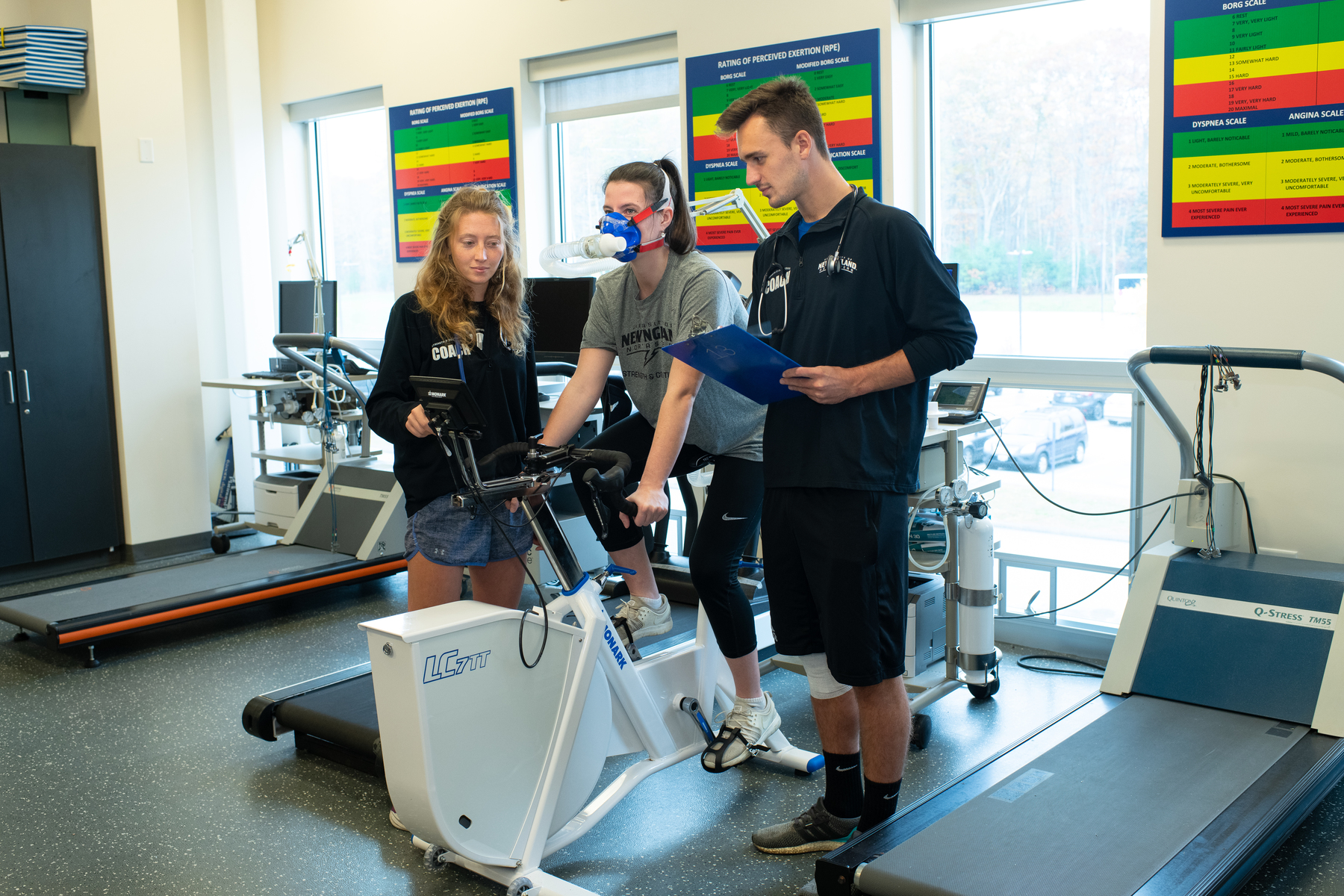 Applied exercise students run an experiment using equipment in The Forum gym