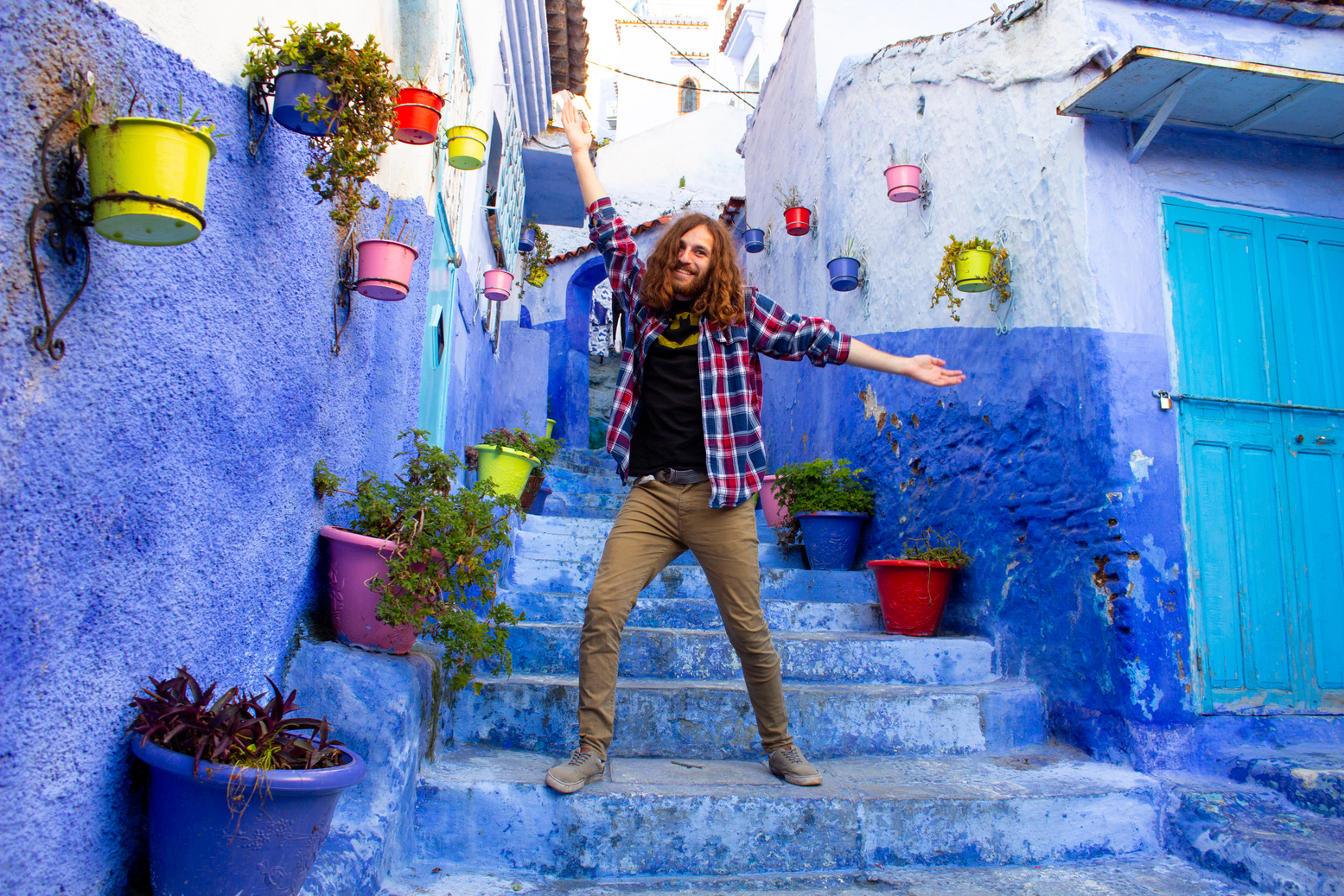 Student in Chefchaouen, Morocco on colorful steps