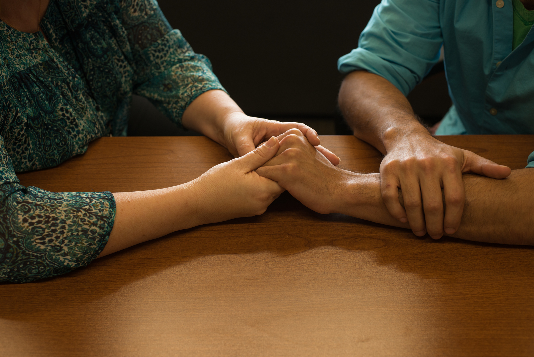 Holding hands at counseling session