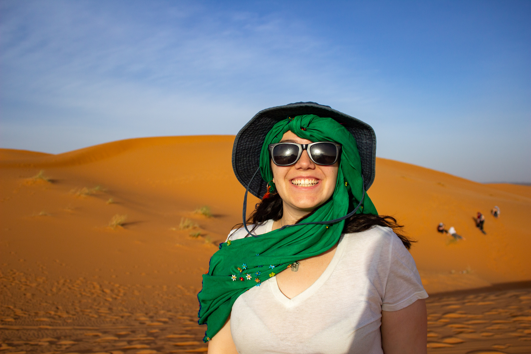 A female student stands in the Sahara Desert