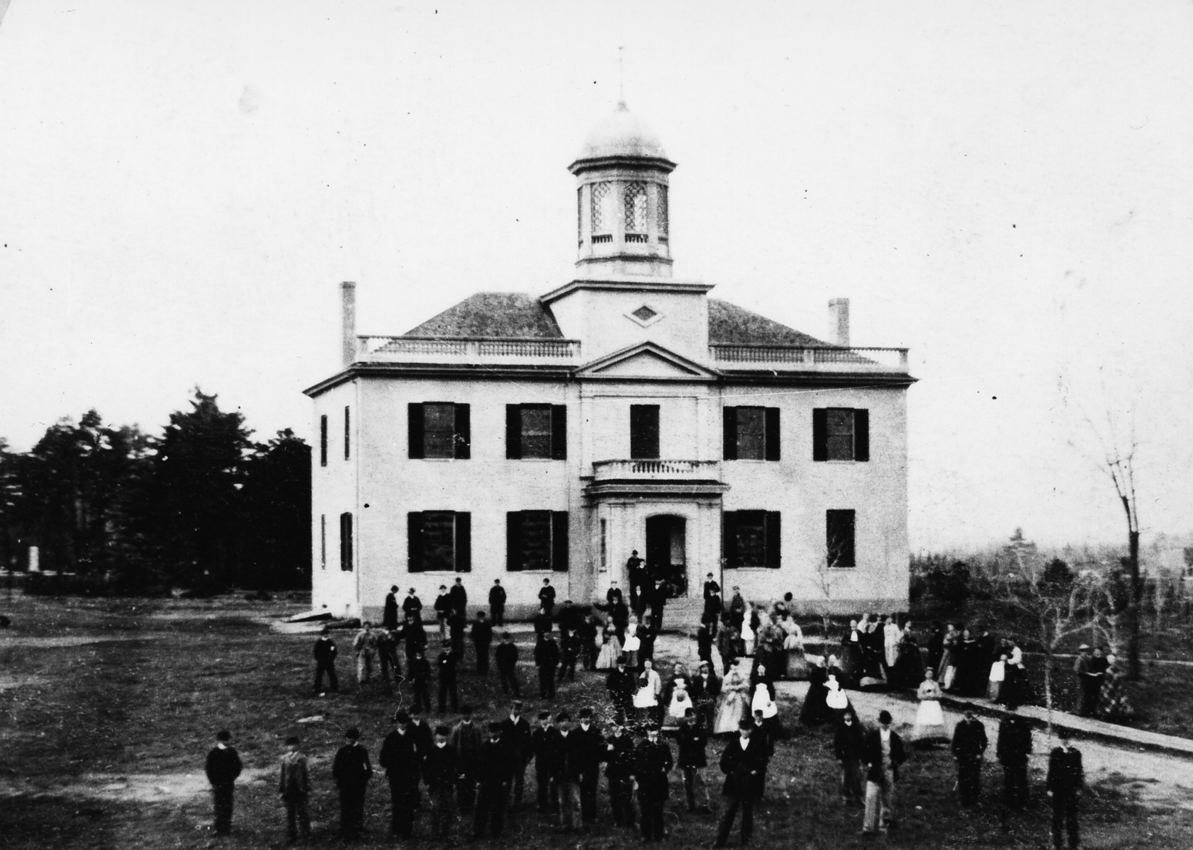 Black and white historic image of students outside St. Francis College