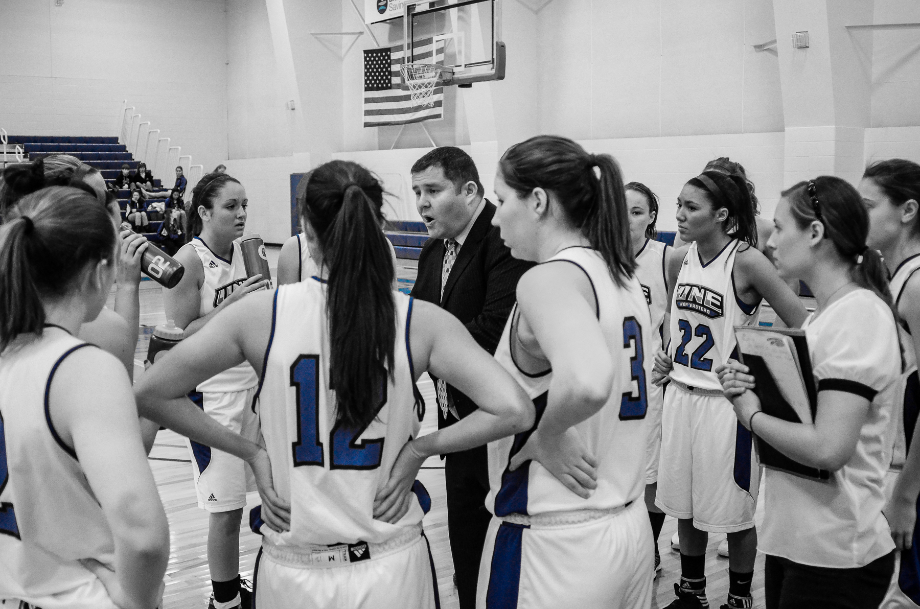 Anthony Ewing Head Women's Basketball Coach talks to players during a game time out