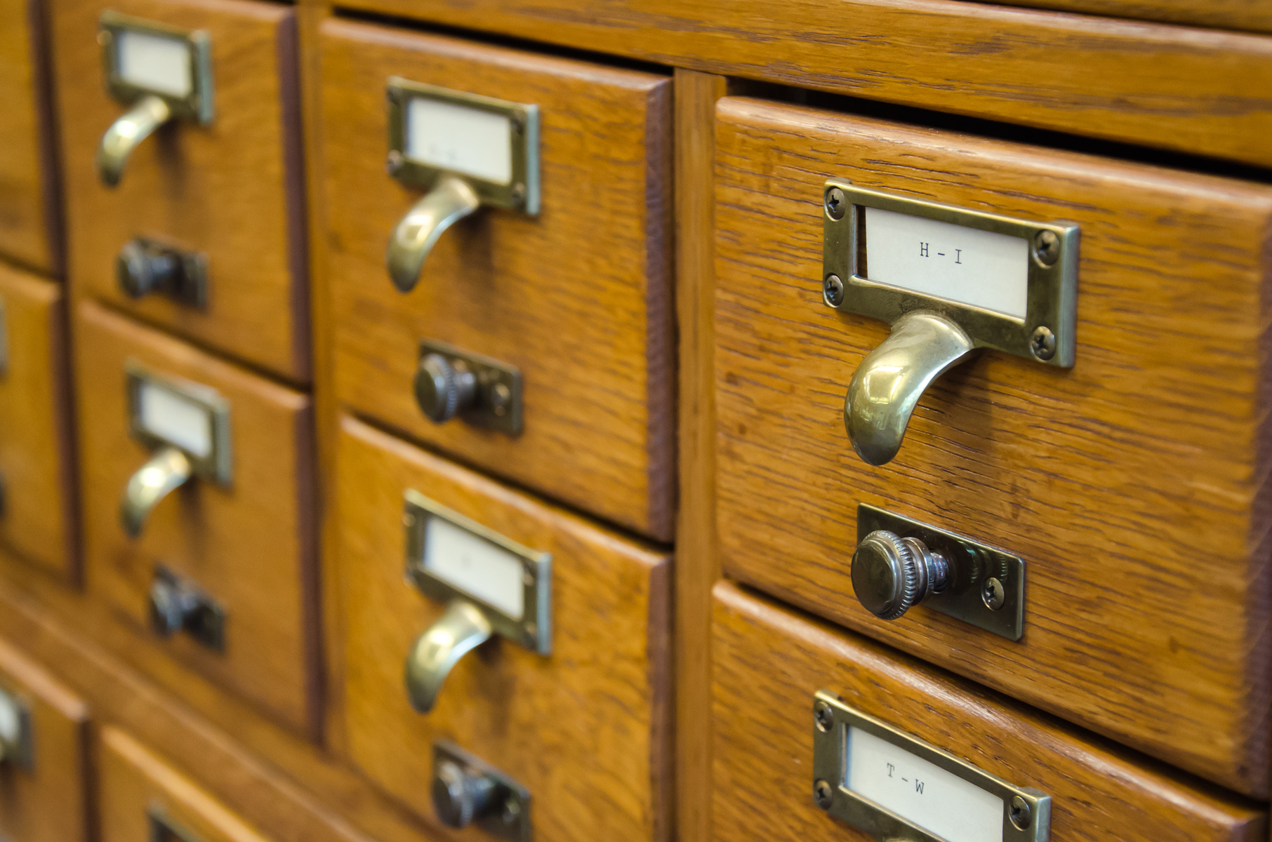 Closeup of library card catalog drawers