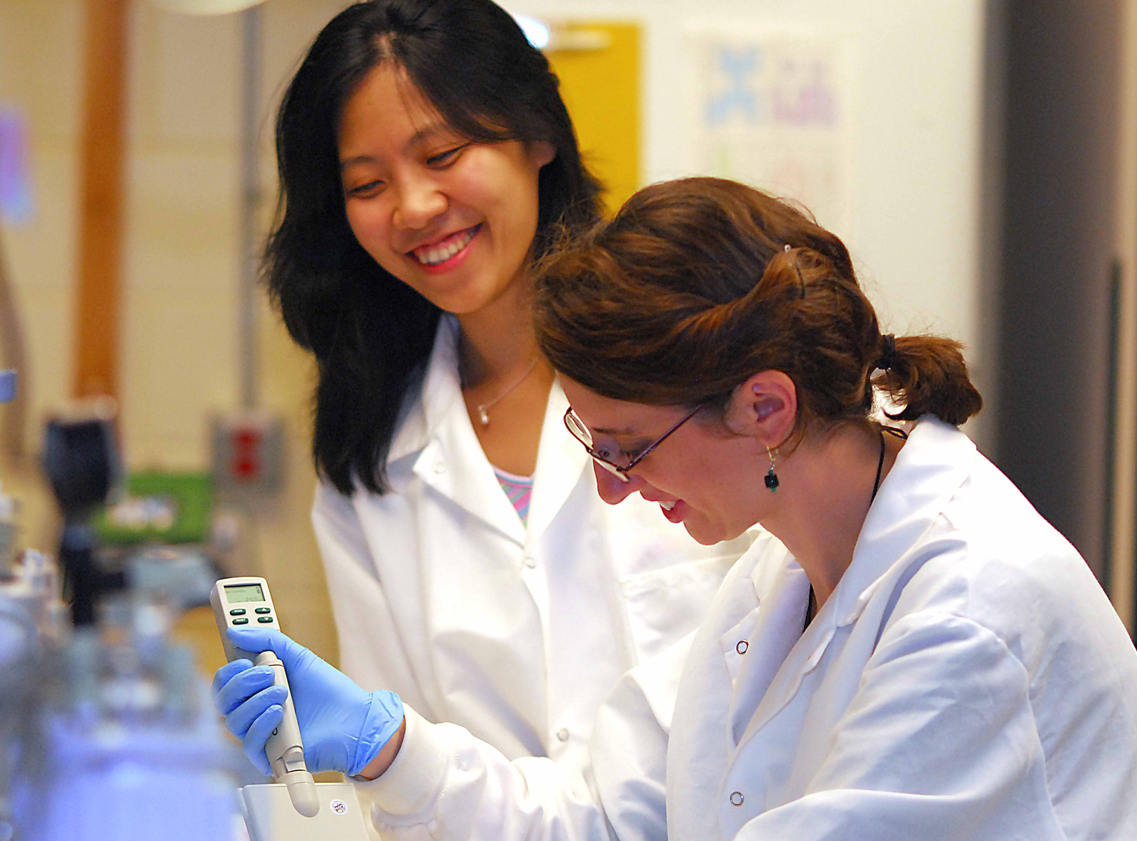 Two female professional students work together in a lab