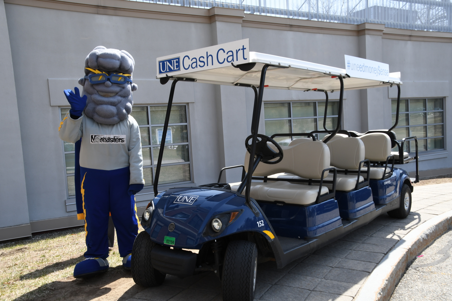 U N E mascot Stormin Norman poses by the cash cart
