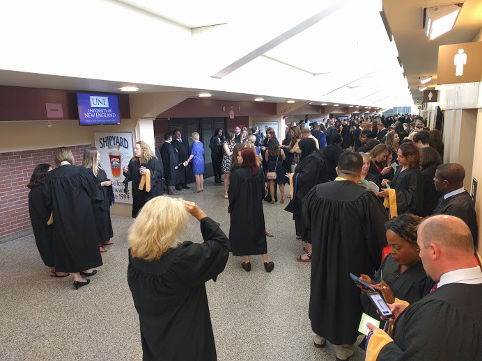social work students line up in a hallway prior to the 2017 graduation hooding ceremony