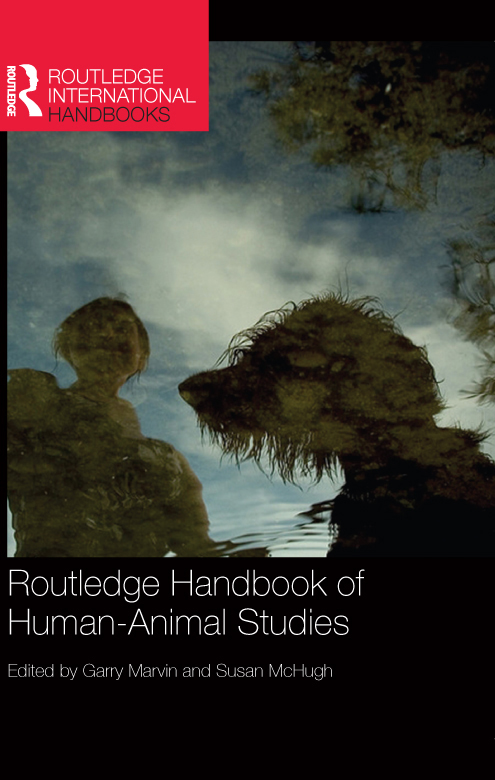 Cover image of Routledge Handbook of Human-Animal Studies featuring a woman and a dog