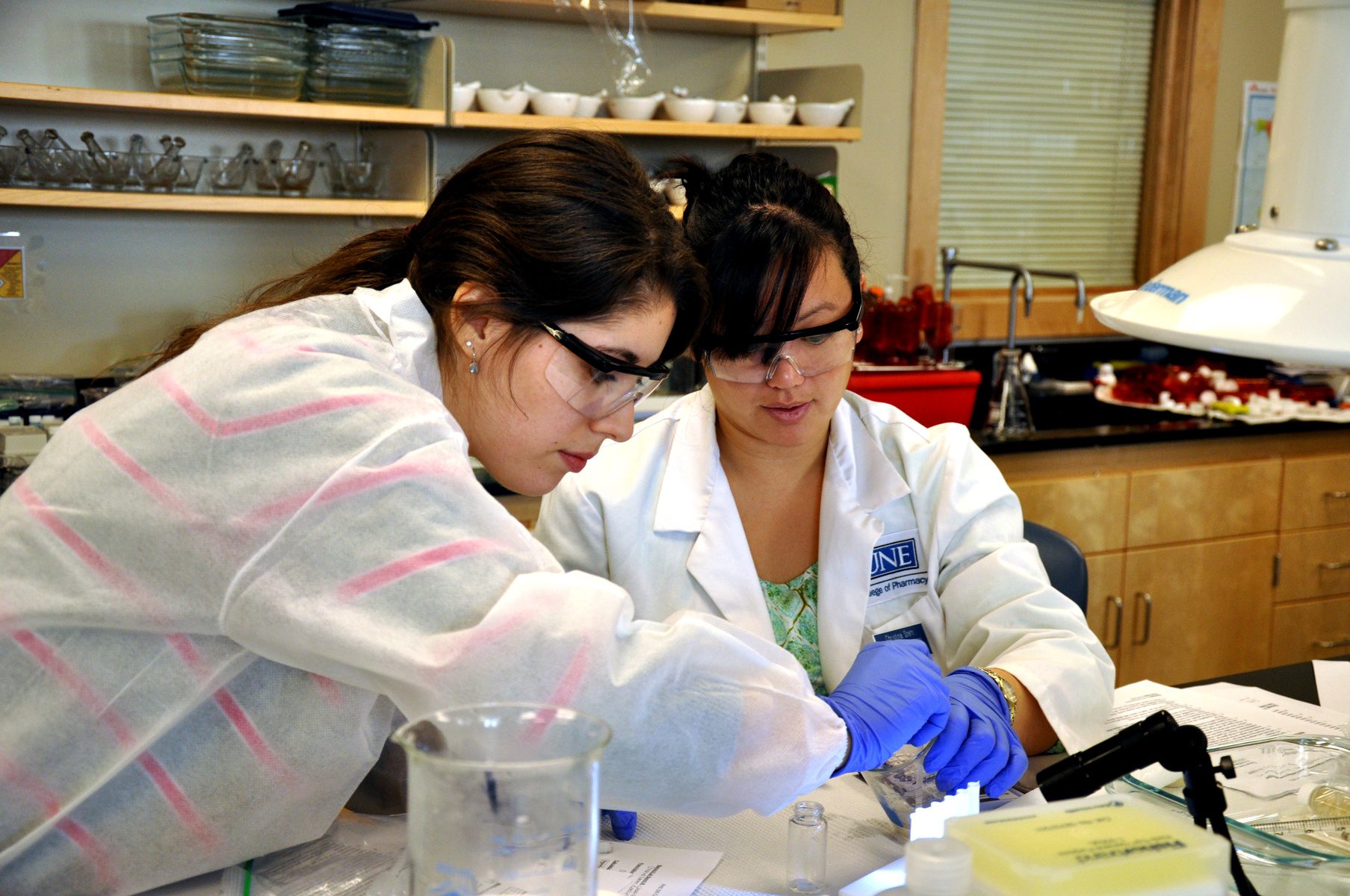 Two female students work together in a lab