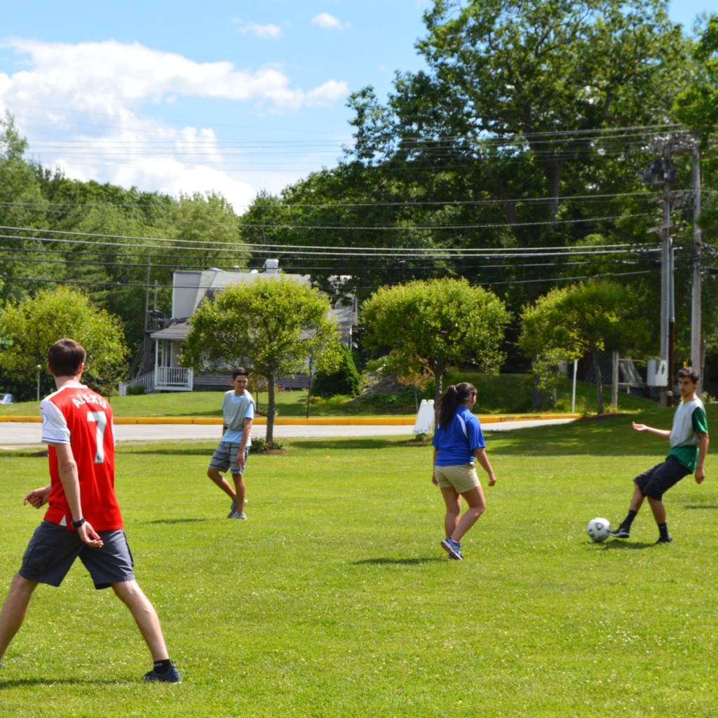 students play soccer outside