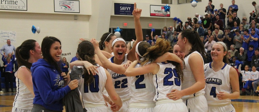 the women's basketball team celebrates a win on the court