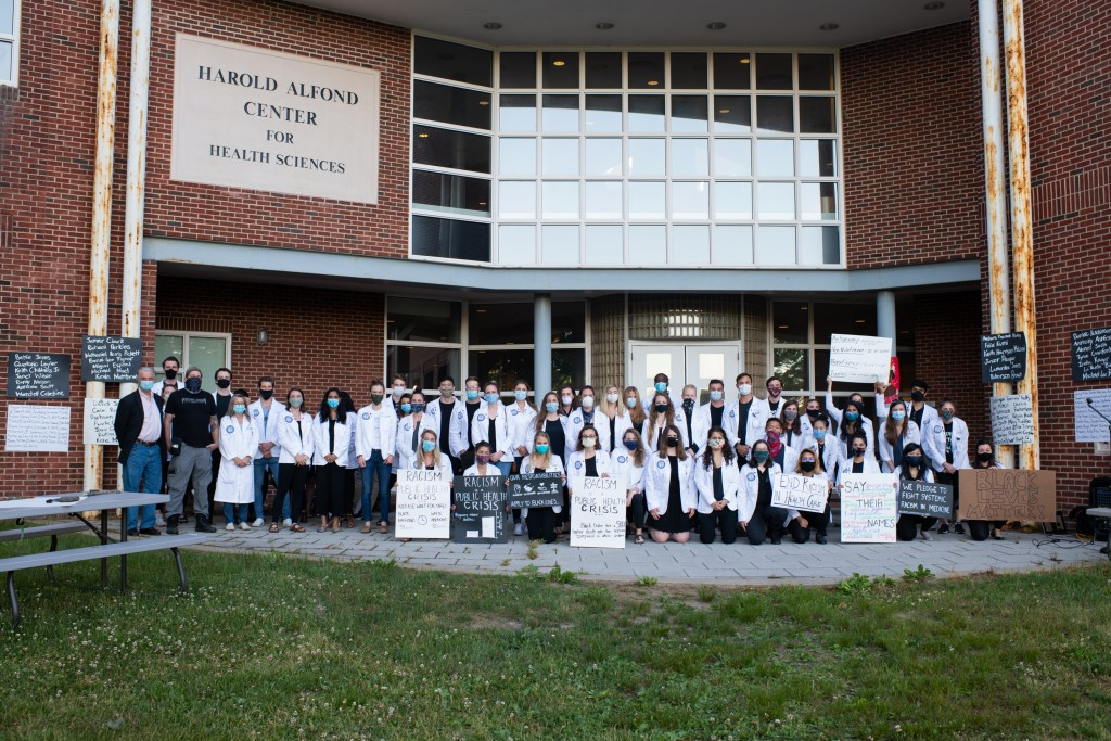 UNE COM students pose following a demonstration for racial equity in health care