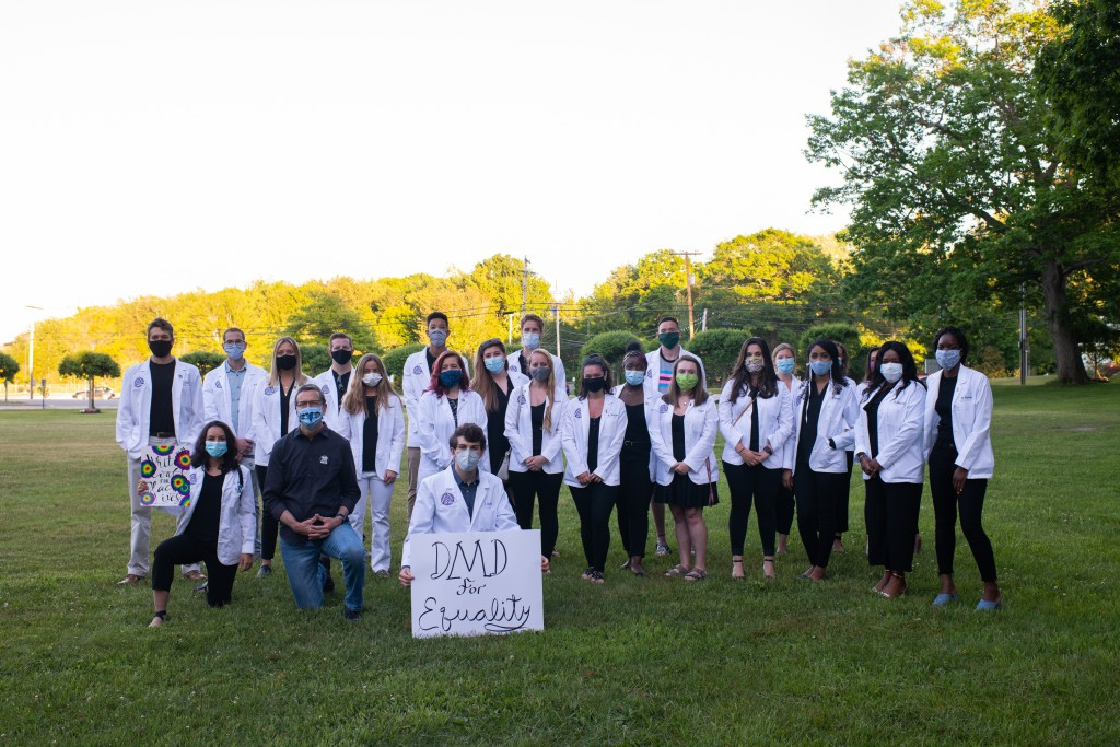 UNE College of Dental Medicine students pose with President James Herbert at the White Coats for Black Lives demonstration on Friday, June 12.
