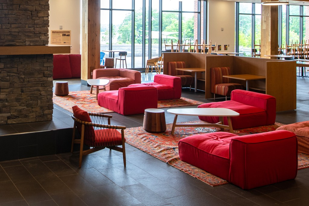 red lounge chairs on the first floor of the Ripich Commons