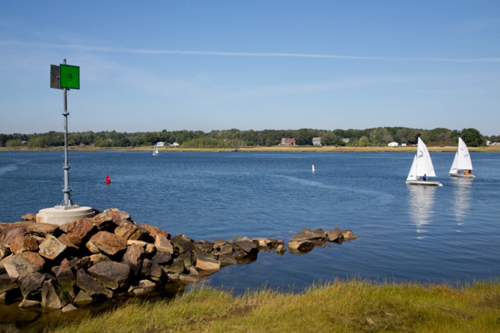 coast on the biddeford campus with two sailboats in the water