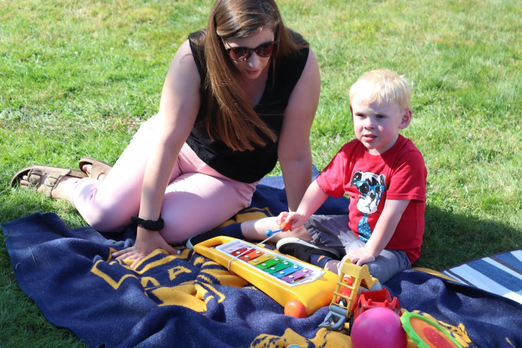LEND trainee Kristy Moody plays with a child at the annual picnic