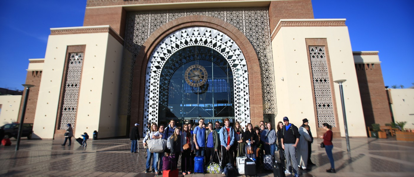 Students arrive at the Marrakesh train station during a group excursion.