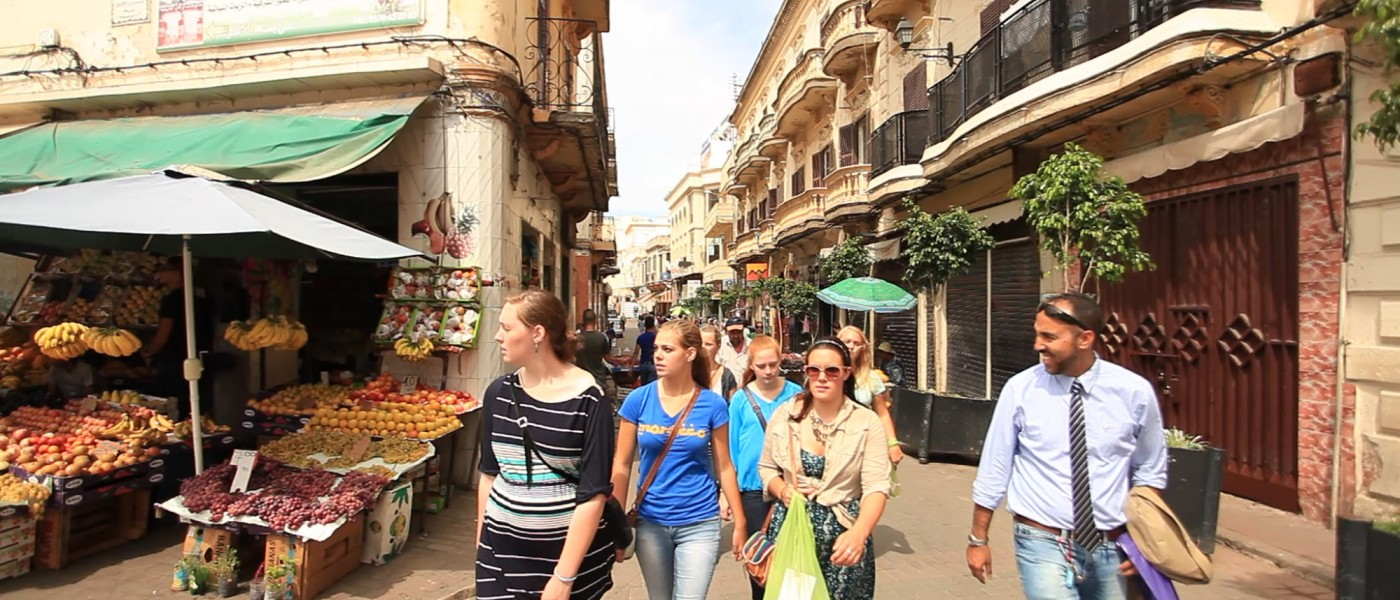 Students walking together through the streets of Tangier.