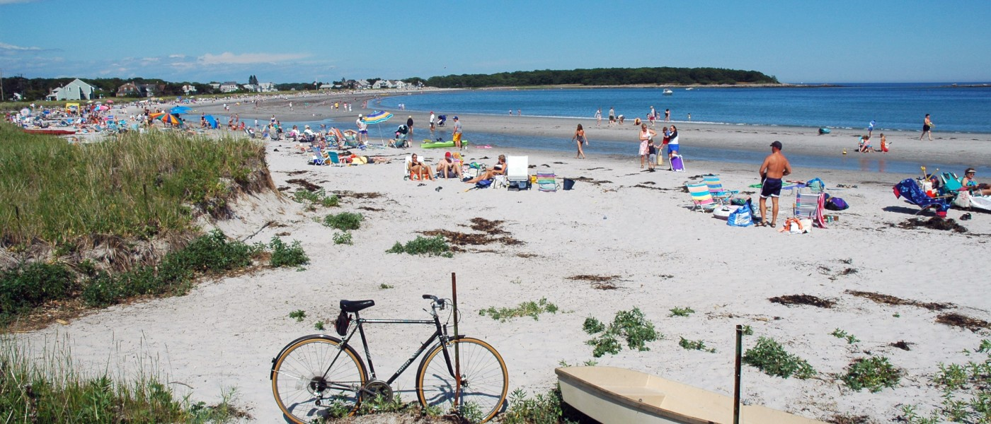 Sunbathers enjoy Kennebunkport Beach on a beautiful summer's day