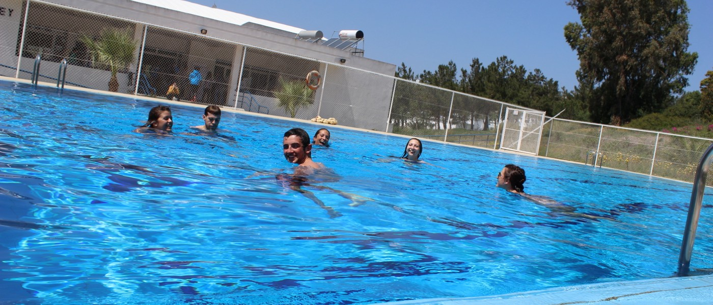 UNE Students swimming at the pool at the American School of Tangier