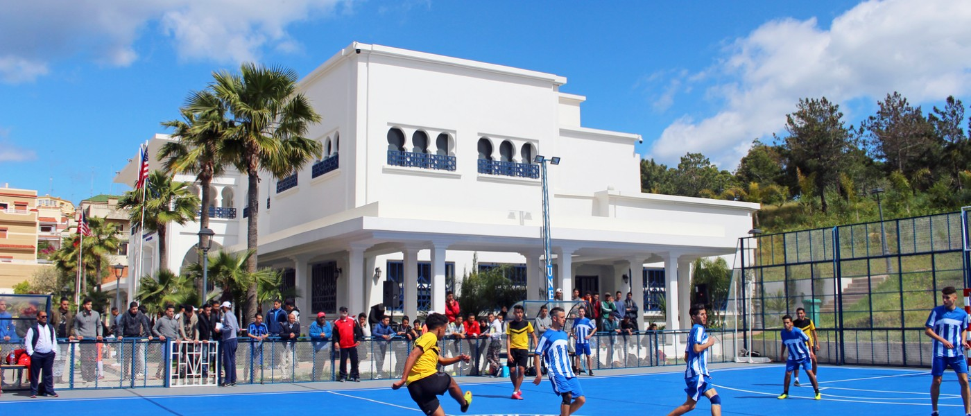 Playing soccer on UNE Tangier, Morocco Blue Sports Court