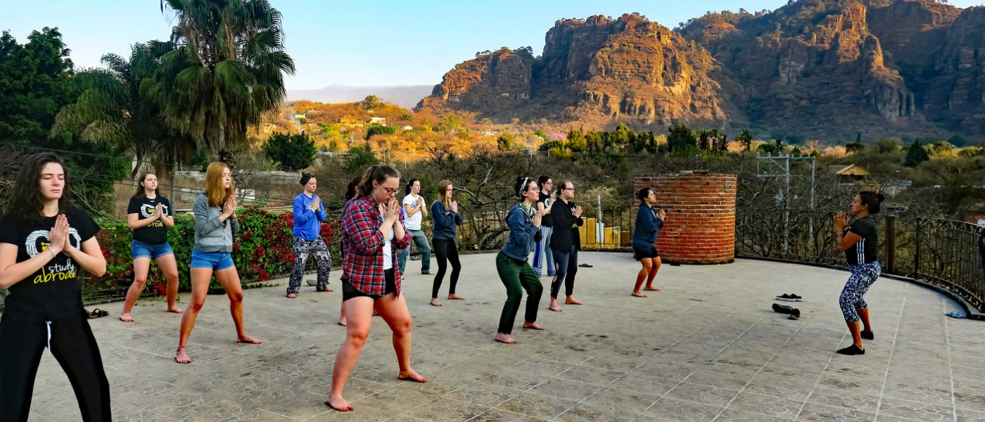 UNE students doing yoga in Mexico