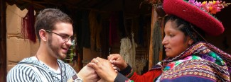 student engaging with indigenous weavers of peru