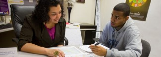 a student receives help from an academic advisor