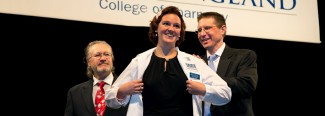 A U N E graduate student in the pharmacy program receiving their white coat