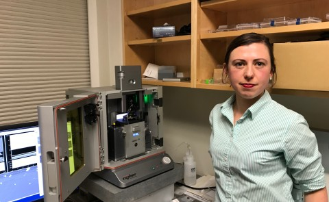 Eve Rose Balog with the state-of-the-art Atomic Force Microscope