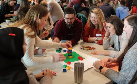 Students from various colleges within the University of New England work together during a collaborative learning activity.